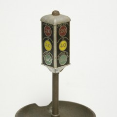 """Traffic light ash tray. Indications read """"We're 20 in '40 and goin' like 60"""""""