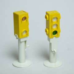 Older PlayMobil manually-changed traffic light in yellow