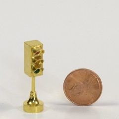 Brass paperweight with gem lenses