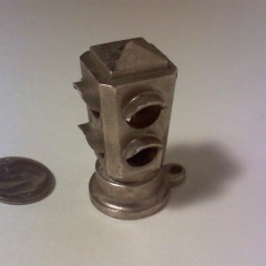Hollow, cast aluminum 4-way. I really have no clue what this was used for