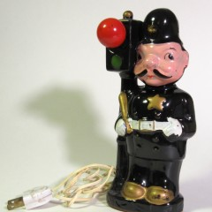 Ceramic policeman and signal with working red light bulb and painted ceramic green section