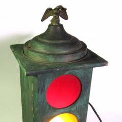 Wooden traffic signal with single 120v bulb and eagle finial