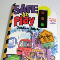 """Safe at Play"" book with light-up signal"