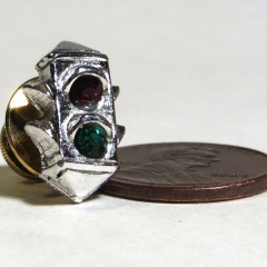 Silver plated pin with red and green rhinestones