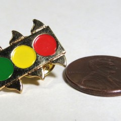 Gold-tone pin with painted lenses