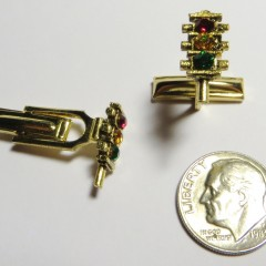 Gold tone three section flat 4-way cufflinks with rhinestone lenses