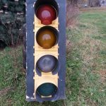 Photo of a traffic signal with a clear lens