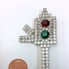 Rhinestone-covered red-green brooch