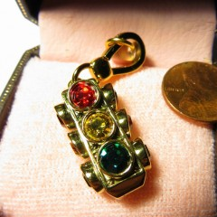 "Juicy Couture 3-way traffic light with rhinestone indications and engraved ""Stop for Style"" on back"
